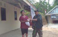 Boinem Terima Sebungkus Daging Qurban Dari TNI