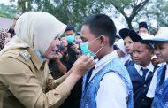 Fitrianti Agustinda Bagikan Masker Kepada siswa dan Masyarakat Palembang