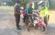 Polsek Pulau Derawan Bagikan Masker Sambil Sosialisasikan Bahaya Karhutla