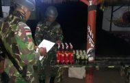 Satgas Pamtas RI-PNG Yonif 411 Kostrad Amankan Puluhan Botol Miras di Jalan Trans Papua