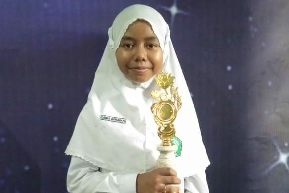 Dania Ramadani, Juara Harapan II Lomba Menulis Festival Literasi Tingkat SD di Pamekasan